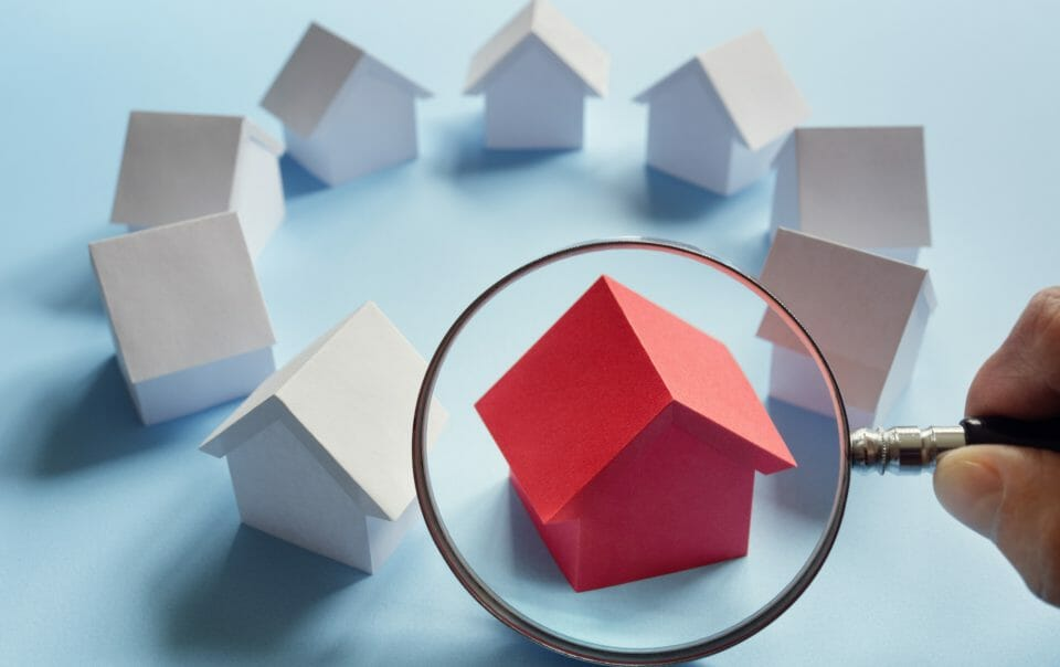 red house under magnifying glass