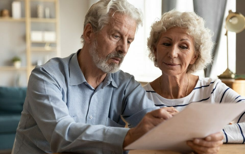 older couple looking at paper