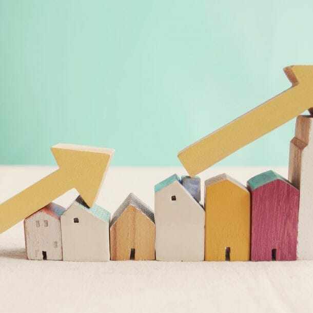 arrows on top of toy houses pointing upwards